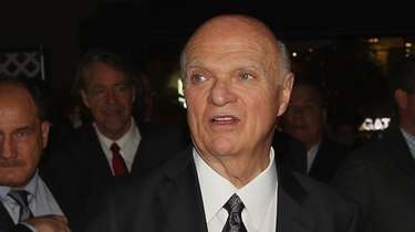 Islanders president and GM Lou Lamoriello walks the