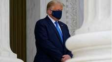 President Donald Trump pays respects last week as