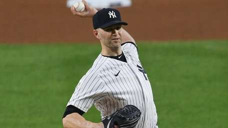J.A. Happ of the Yankees pitches during the