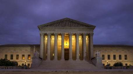 The U.S. Supreme Court building before dawn in