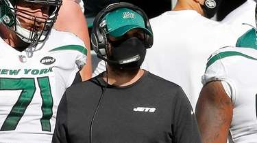 Jets head coach Adam Gase looks on against