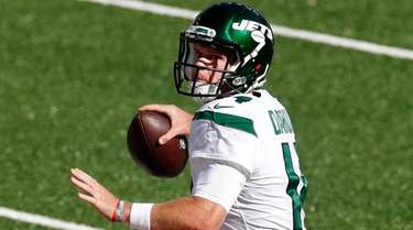 Sam Darnold of the Jets looks to pass