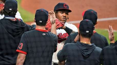Cleveland's Jose Ramirez is congratulated by teammates after