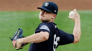 Clarke Schmidt of the Yankees pitches during a