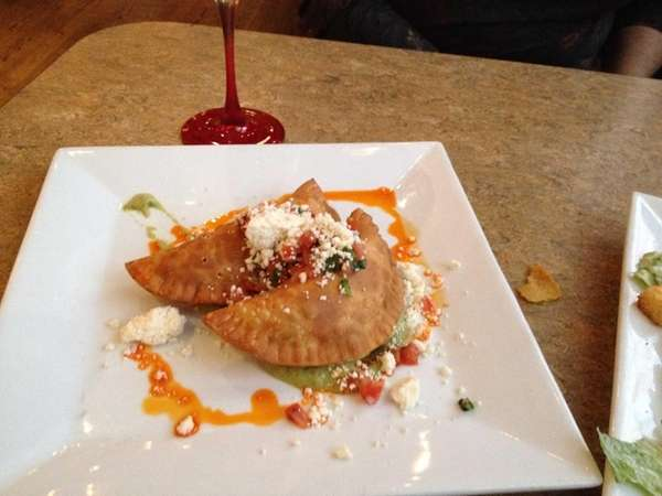 Pulled pork-and-chorizo empanadas are served at Fuego Picante