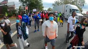 Protesters marched in Hicksville on Saturday demanding justice