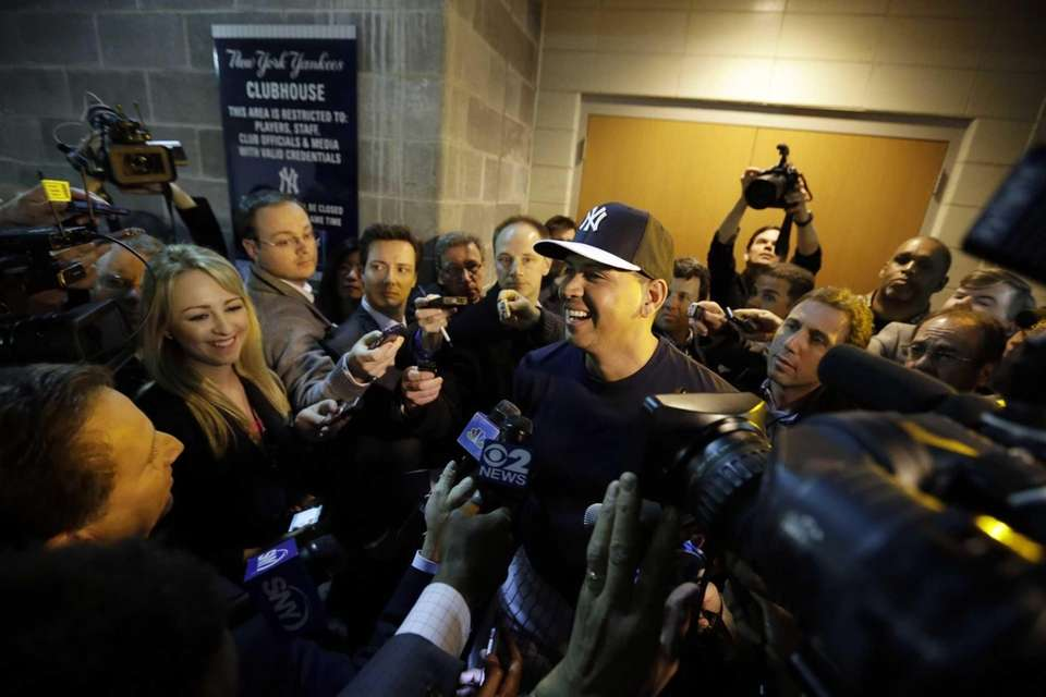 Alex Rodriguez laughs as he talks with the