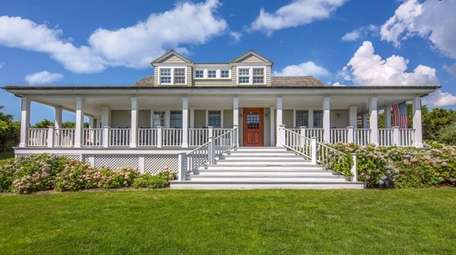 The wraparound, mahogany porch is perfect for enjoying