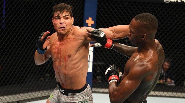 Paulo Costa of Brazil punches Israel Adesanya of