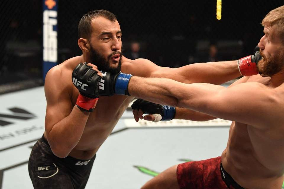 Dominick Reyes punches Jan Blachowicz of Poland in