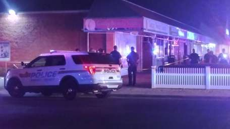 Nassau police early Sunday investigate a shooting outside