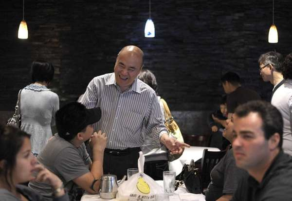 Owner Tommy Tan speaks to customers at The