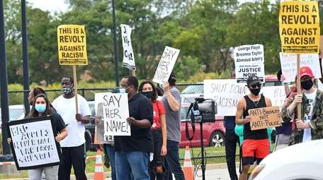 Protesters gathered at Brentwood State Park Sunday to