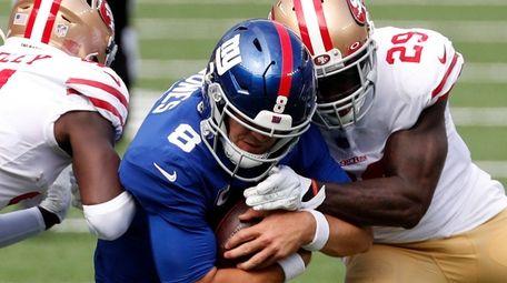 Daniel Jones #8 of the Giants is hit