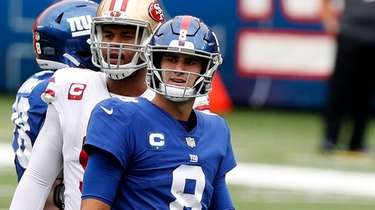 Daniel Jones #8 of the Giants looks on