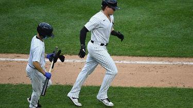 Yankees designated hitter Luke Voit draws a walk
