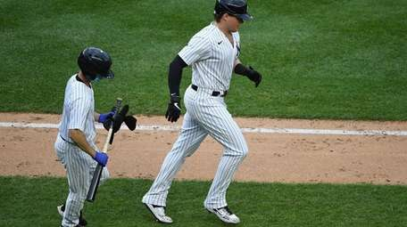 Yankees designated hitter Luke Voit draws a walk