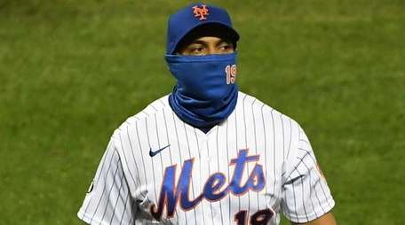 Mets manager Luis Rojas walks to the dugout