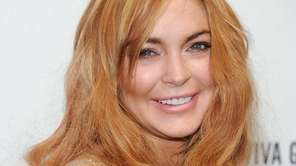 Lindsay Lohan attends the amfAR's gala at Cipriani