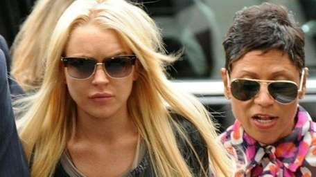 The highly publicized troubles of Lindsay Lohan, left,