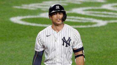 Giancarlo Stanton #27 of the Yankees walks back
