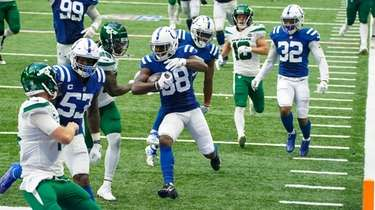 Indianapolis Colts cornerback T.J. Carrie (38) runs in