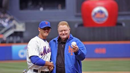 Anthony Recker and Rusty Staub pose for photographers