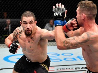 Robert Whittaker of New Zealand punches Darren Till
