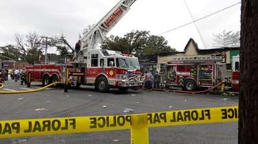 Firefighters at the scene Sunday of a fire
