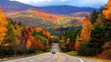 A scenic road in the Adirondacks, where colors