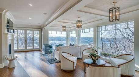 The house has high ceilings and expansive windows,