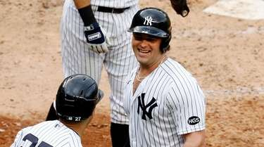 Luke Voit #59 of the Yankees celebrates his