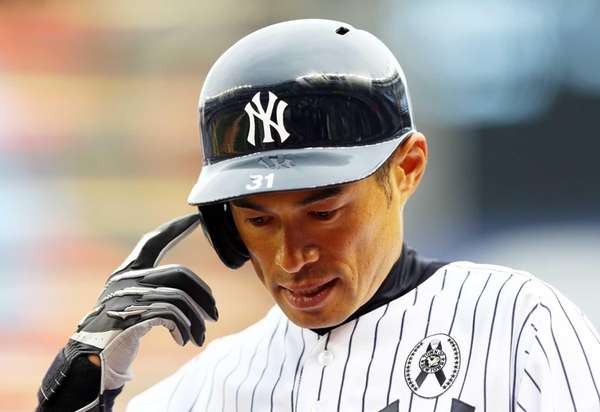 Ichiro Suzuki reacts after hitting into a double