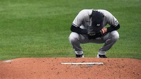 Yankees starting pitcher Gerrit Cole takes a moment