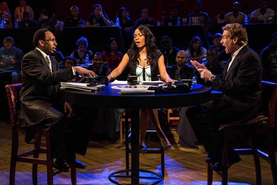 Cari Champion sits between the two shouting heads