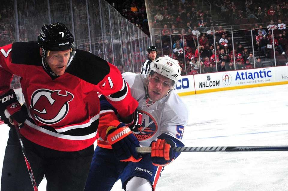 Casey Cizikas of the New York Islanders forces