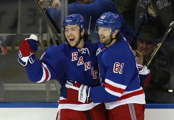 Derek Stepan, left, of the New York Rangers