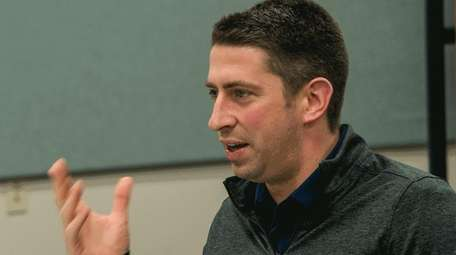 Cleveland general manager Mike Chernoff answers a question