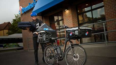 The pizza delivery giant Domino's reports earnings this