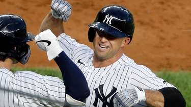 Brett Gardner #11 of the Yankees celebrates his