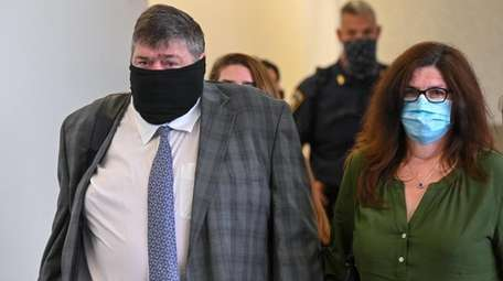 Thomas Murphy leaves a Suffolk County courtroom in