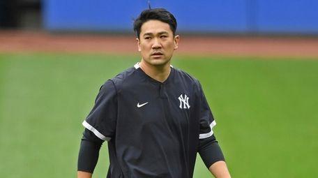 Yankees starting pitcher Masahiro Tanaka walks on the