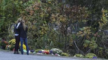 People mourn at the site of the fatal