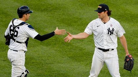 Gerrit Cole and Kyle Higashioka of the Yankees