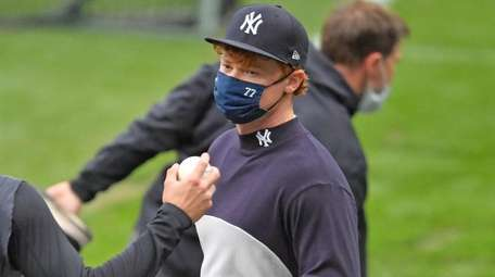 Clint Frazier of the Yankees warms up prior