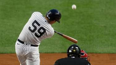 Luke Voit #59 of the Yankees connects on