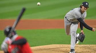 Yankees starting pitcher Gerrit Cole (45) delivers to
