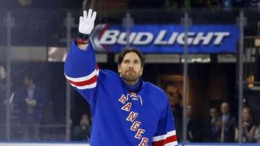 Henrik Lundqvist of the Rangers waves to the