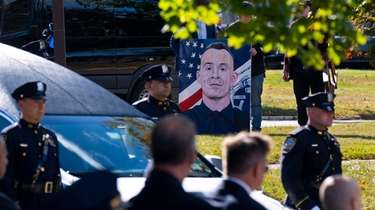 A portrait of NYPD officer Brian Mulkeen is