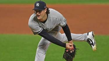 Yankees starting pitcher Gerrit Cole (45) delivers in